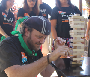 BCG's EVP Patrick Nooren competing in the Jenga challenge